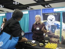 Conference attendees visiting the NAHETS exhibit booth